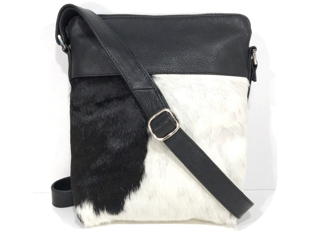 0c3229d7a4 Harriet - Black and White Cowhide Messenger Bag