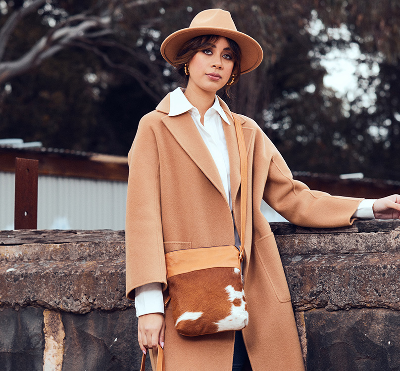Harriet tan and white cowhide bag