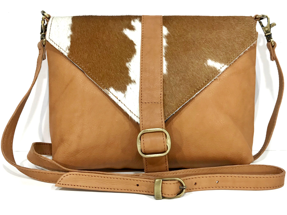 Stunning Mila Cowhide Sling Bag featured in Vogue's December issue!