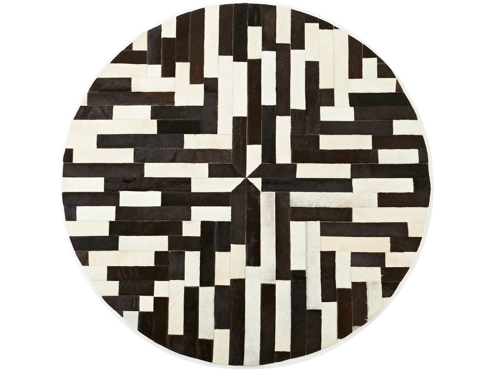 'Circulaire', our range of statement, meticulously handcrafted round cowhide rugs